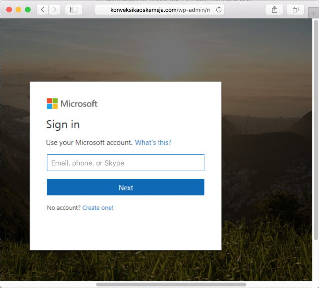 A fake Microsoft login page is presented by the link.
